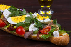 Greek Steak Salad on Bread with Eggs and Feta. Royalty Free Stock Image
