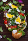 Greek Steak Salad on Bread with Eggs and Feta. Stock Photo