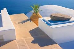 Greek Still-life, Santorini. Brilliant white architectural details against a bright blue sea  in Oia, Santorini, Greece Stock Photos