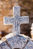 Greek stone cross on burial ground. Architecture detail, Vathia Mani Greece stock image