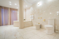 Greek style bathroom. Spacious greek style bathroom with marble floor stock image