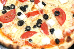 Greek style pizza. Feta cheese and olives pizza Stock Image