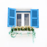 Greek Style windows and flower Royalty Free Stock Photo