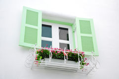 Greek Style windows with green retro wooden shutters Royalty Free Stock Images