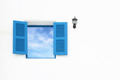 Greek style windows and lamp with blue sky Royalty Free Stock Image