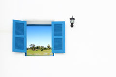 Greek style windows and lamp with country filed Royalty Free Stock Images