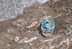 Greek summer bracelets with evil eye on beach Royalty Free Stock Images