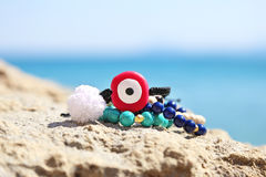 Greek summer jewelry on the beach stock photo