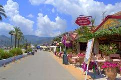 Greek summer resort promenade restaurants Stock Image