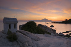 Greek sunrise. The amazing silhouette of mount Athos rising from the Aegean sea and symbol of Greek orthodox Christianity at sunrise Stock Image