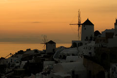Greek Sunset. The sun has just disappeared behind the horizon, and the light is beautiful and creates an amazing and gorgeous silhouette of the town of Oia (Ia) Stock Photography