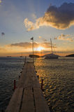 Greek sunset. Golden sunset over boats moored in a bay on a calm sea Royalty Free Stock Photos