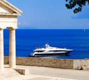 Greek symbol Pantheon near the sea with yacht Royalty Free Stock Photos