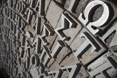 Greek symbols and letters on a monument Stock Photo