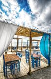 Greek tavern on beach Royalty Free Stock Image