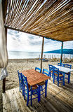 Greek tavern on beach Royalty Free Stock Images