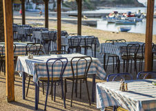 Greek tavern with blue chairs, Greece Royalty Free Stock Images