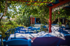 Greek tavern with blue chairs Stock Images