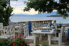 Greek tavern on the coast of the Mediterranean Sea Royalty Free Stock Photos