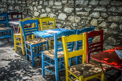 Greek Tavern. Colorful chairs in a small Greek tavern Stock Photo