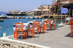 Greek tavern with orange wooden chairs, Santorini , Greece Stock Image