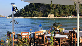 Greek tavern by the sea coast Royalty Free Stock Image