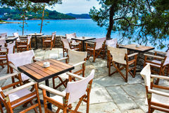 Greek tavern in Skiathos with view over the blue sea Royalty Free Stock Photos