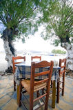 Greek taverna chairs table Antiparos Island. Typical taverna restaurant table with woven Greek chairs seaside in Antiparos Island Cyclads Greek islands royalty free stock photography