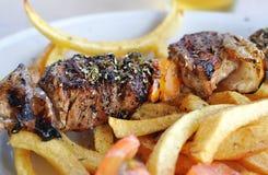 Greek taverna lamb souvlaki Stock Photos