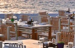 Greek taverna near the sea. In Mykonos, at sunset royalty free stock image