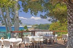 Greek taverna by sea Stock Photography