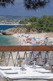 Greek taverna by sea. With beach in background royalty free stock photo