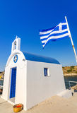 Greek temple with flag - vertical view Stock Images
