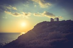 Greek temple of Poseidon, Cape Sounio. Greece Cape Sounion. Ruins of an ancient temple of Poseidon, Greek god of the sea, at sunset. Travel destinations royalty free stock photography