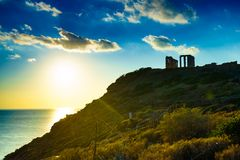 Greek temple of Poseidon, Cape Sounio. Greece Cape Sounion. Ruins of an ancient temple of Poseidon, Greek god of the sea, at sunset. Travel destinations stock photos