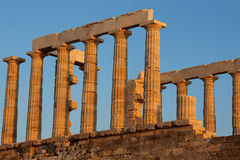 Greek Temple of Poseidon Sounio. The ruins of the greek doric order temple of Poseidon at sunset with its marble columns. Cape Sounio, mainland Greece stock photography