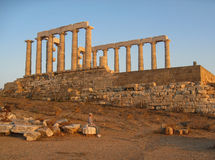 Greek Temple of Poseidon Sounio. The ruins of the greek doric order temple of Poseidon at sunset with its marble columns. Cape Sounio, mainland Greece stock photos