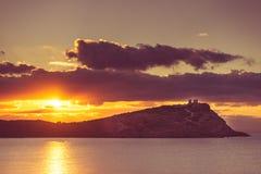 Greek temple of Poseidon at sunrise, Cape Sounio Stock Photos