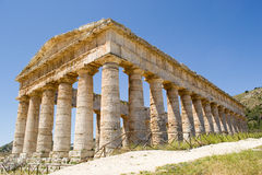 Greek Temple Segesta in bright sunshine. The unfinished temple of Segesta in Sicily, Italy. He measures 21 x 56 m with 6x14 columns. He is preserved in an almost Royalty Free Stock Photos