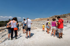 The Greek theater in Syracuse, Sicily. Syracuse, Sicily, Italy – July 17, 2013:  Tourists admire the Greek theater in Syracuse, Italy. This 2700 year-old Stock Photography