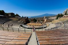 Greek theater in Taormina with the Etna volcano in the background Royalty Free Stock Photography