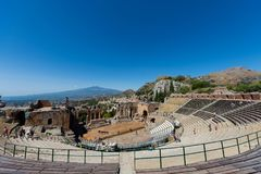 Greek theater in Taormina with the Etna volcano in the background Stock Images