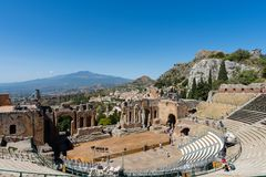 Greek theater in Taormina with the Etna volcano in the background Stock Photography