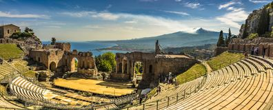 The Greek theater in Taormina, Mount Etna and the Mediterranean Sea royalty free stock image