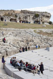 Greek Theatre of Syracuse, Italy. Group tour with guide. Royalty Free Stock Photos