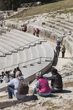 Greek Theatre of Syracuse, Italy. Tourists in the stands Stock Image