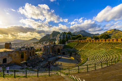 Greek theatre in Taormina at sunset. The Ancient theatre of Taormina, constructed by the Greeks in the 3rd century BC is one of the most famous theatres in the Stock Photos