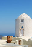 Greek Tower. Beautiful Santorini landscape with white tower on blue sky background Royalty Free Stock Images