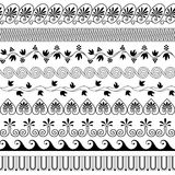 Greek traditional borders. Set of brushes to create the Greek Meander patterns.Greek traditional borders. Decoration elements in black color isolated on white Royalty Free Stock Photography