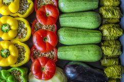 Greek traditional food Gemista. Stuffed peppers, tomatoes, zucchini, eggplant, potato and vine leaves with with rice, vegetables. Greek traditional food Gemista royalty free stock photography